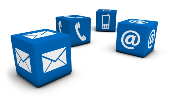 Web contact us Internet concept with email mobile phone and at icon and symbol on four blue cubes for website blog and on line business.